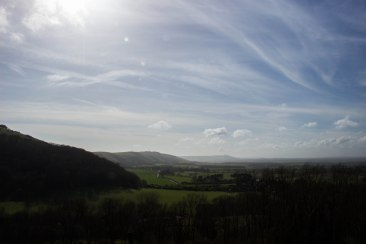 Dyke Hill, wooded on the left. Truleigh Hill with the radio masts on its summit and Chanctonbury Ring visible to its right
